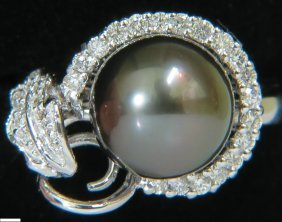 18kt 10.3mm Natural Tahitian Black Lipped Oyster Pearl