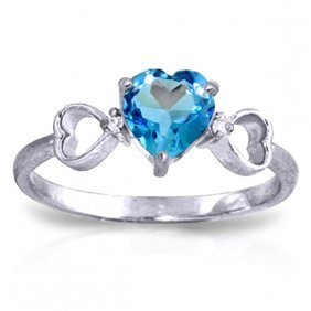 14k White Gold Carry You Home Blue Topaz Diamond Ring
