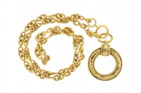 A CHANEL GOLDTONE MAGNIFYING GLASS PENDANT NECKLACE