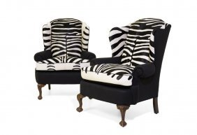 A Pair Of Chippendale Style Zebra Hide Wingback Chairs