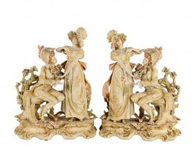 A Pair Of Continental Bisque Figural Groups