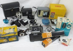 Collection Of Cameras And Photography Equipment