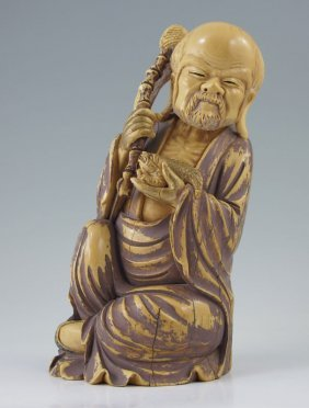 CARVED AND PAINTED IVORY ELDER FIGURE