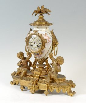 FRENCH BALTHAZAR FIGURAL GILT AND PORCELAIN CLOCK