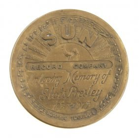 An Elvis Presley Commemorative Sun Records Belt Buck