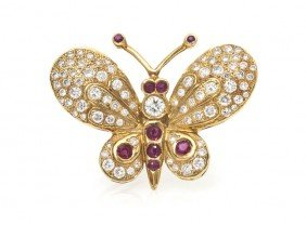 A 14 Karat Yellow Gold, Ruby And Diamond Butterfly
