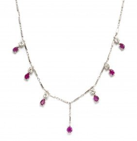 A 14 Karat White Gold, Ruby And Diamond Necklace,