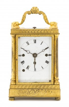 A Continental Gilt Bronze Carriage Clock, Height 5