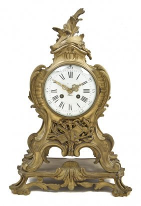 A Louis XVI Gilt Bronze Mantel Clock, Height 18 5/