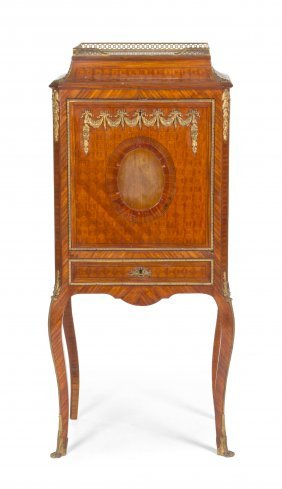A Louis XVI Style Parquetry And Gilt Bronze Mounte