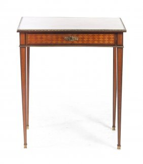 A Louis XVI Style Parquetry And Gilt Metal Mounted
