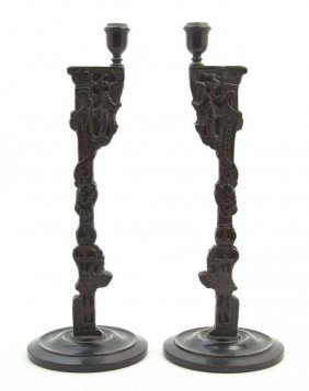 A Pair Of Chinoiserie Carved Ebonized Wood Candle