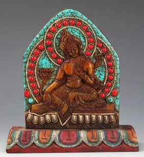 A Turquoise And Wooden Carved Tibetan Buddha Figure