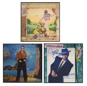 Three Album Covers Signed By Elton John