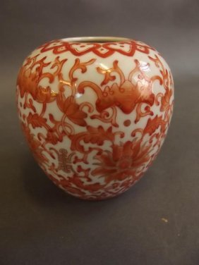 A Small Chinese Porcelain Vase With Orange And Gilt