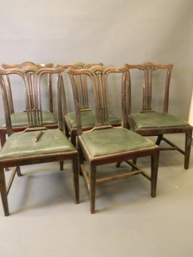 A Set Of Four Mahogany Dining Chairs With Carved And