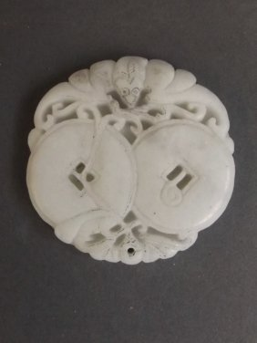 A Chinese White Jade Pendant With Carved Bat And