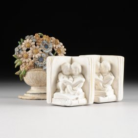 A Pair Of White Plaster Figural Book Ends And One