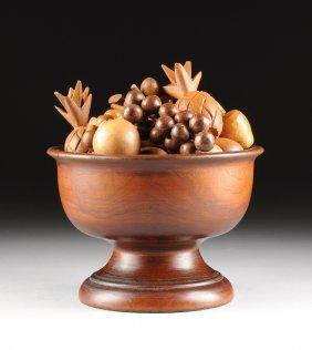 A Thirty One Piece Vintage Carved Walnut Bowl And
