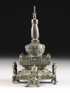 A Sino Tibetan Patinated Bronze Buddhistic Stupa Form