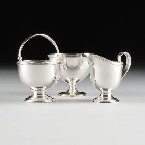 A Tiffany & Co. Art Deco Sterling Silver Partial Tea