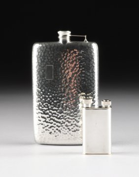 An Arthur Dunhill, Ltd. Silver Plated Lighter Filler,