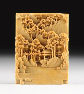 A Chinese Intricately Carved Ochre Jade Plaque,