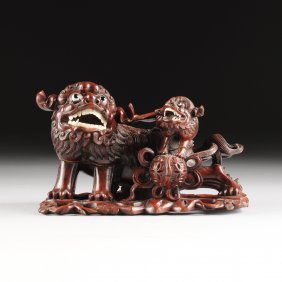 A Chinese Carved Rosewood Buddhistic Lioness And Cub,