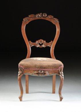 A Victorian Balloon Back Carved Walnut Salon Chair,