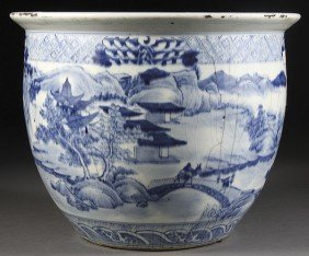 A CHINESE QING DYNASTY BLUE AND WHITE CERAMIC FISH