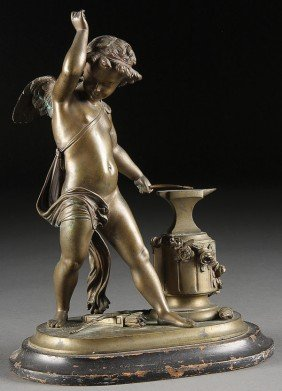 A FRENCH EMPIRE BRONZE FIGURE OF CUPID