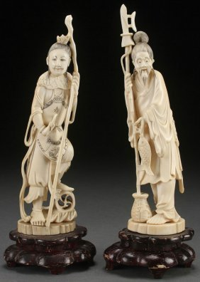A Pair Of Japanese Carved Ivory Figures