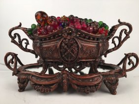 Glass Fruit Basket In A Bronze Two Handled Basket.