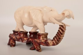 Carved Elephant With His Trunk Up.