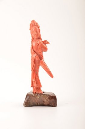 Coral Figure Of A Lady Holding An Umbrella And A