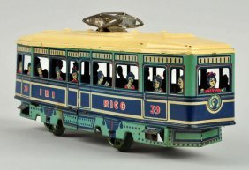 Spanish Rico Tin Litho Wind Up Trolley Toy.