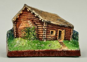 Cast Iron Lincoln's Log Cabin Doorstop.