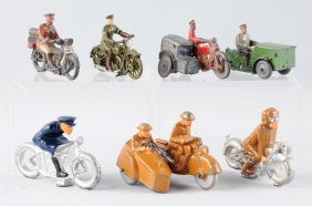 Lot Of 7: Cast Iron Motorcycle Toys.