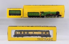 Lot Of 3: Trix Locomotive And Cars.