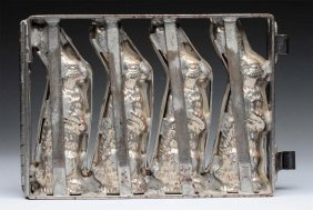 Early Chocolate Mold Of Four Rabbits.