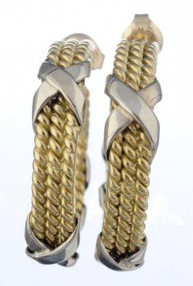 A Pair Of Gold Hoop Earrings.