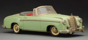 German Schuco Tin Mercedes 220s Convertible Coupe.