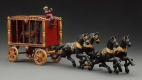 Small Hubley 4-horse Circus Cage Wagon.