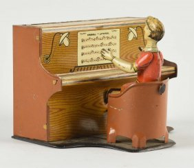 Unusual German Tin Litho Piano Player Toy.