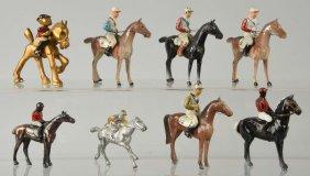 Lot Of Assorted Racing Horses With Jockeys.