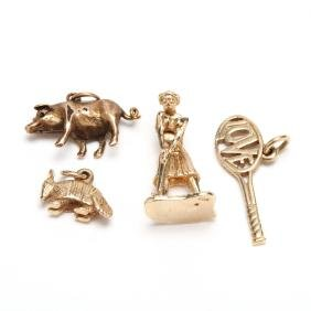 Four Gold Charms