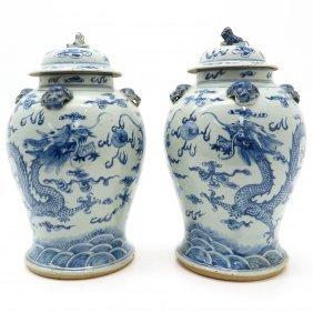 Pair of Lidded Vases