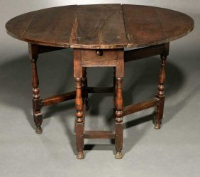 An English Oak Gate-leg Drop-leaf Table