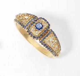 A Sapphire, Diamond And Gold Bangle