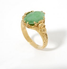 A Jade Cabochon And Gold Ring